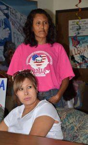 Jeanette Vizguerra (back) & Ana Souzameda, spouse of Arturo Hernandez Garcia