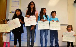 "Children of immigrants in Denver launch ""This is My American Story"" campaign with posters that say (in Spanish), ""I have a wish ... that one day ... all my family could stay here ... my mom and my dad will always be with me ... that my mom and my paper will return ... that I no longer have to be afraid ."" Photo by Gabriela Flora, AFSC."
